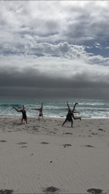 Cartwheeling on white sand with the beautiful Bay of Fires Background